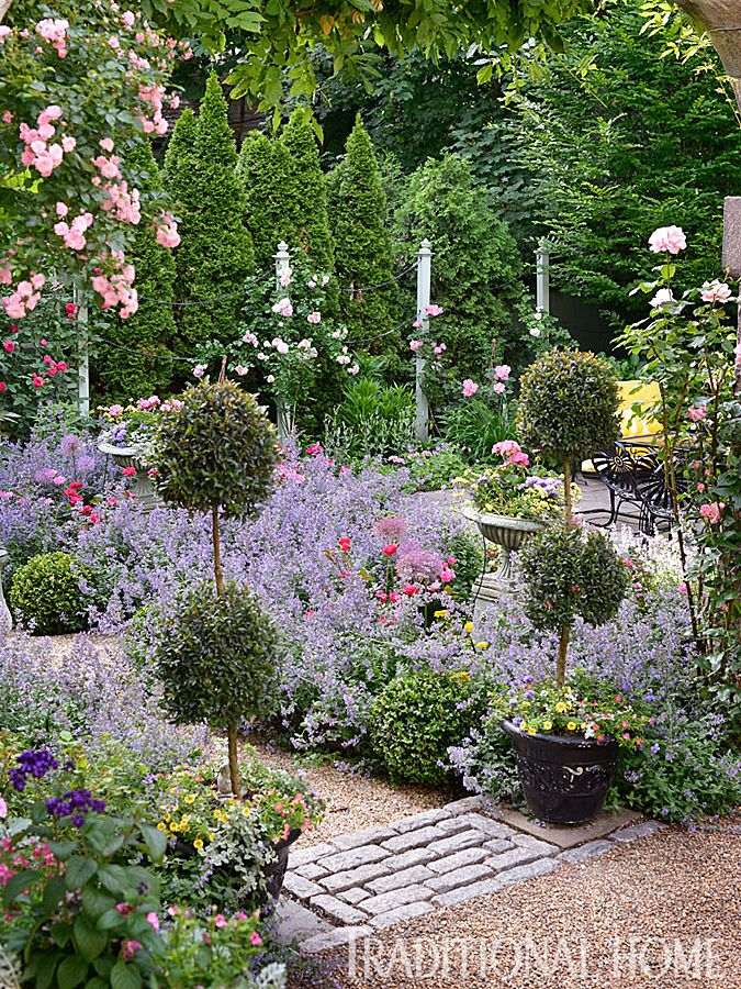 Square Perennial And Vegetable Beds Demarked With Potted