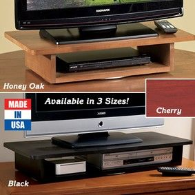 TV/DVD Swivel Stand offers 360º viewing! Wooden stand's smooth-turning, ball-bearing base swivels a full 360º. Lower shelf holds most VCRs, DVD or Blu-Ray players.