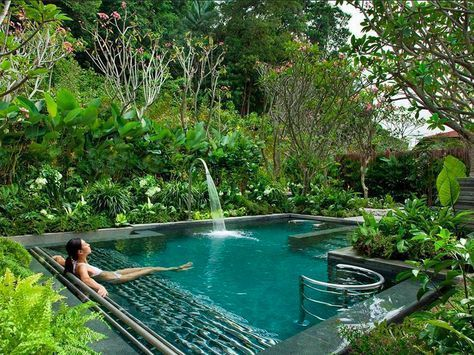 A pool with a waterfall tropical spa style at home Pool