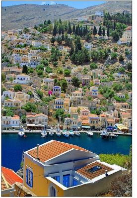 Sailing into Symi harbour is an explosion of colour