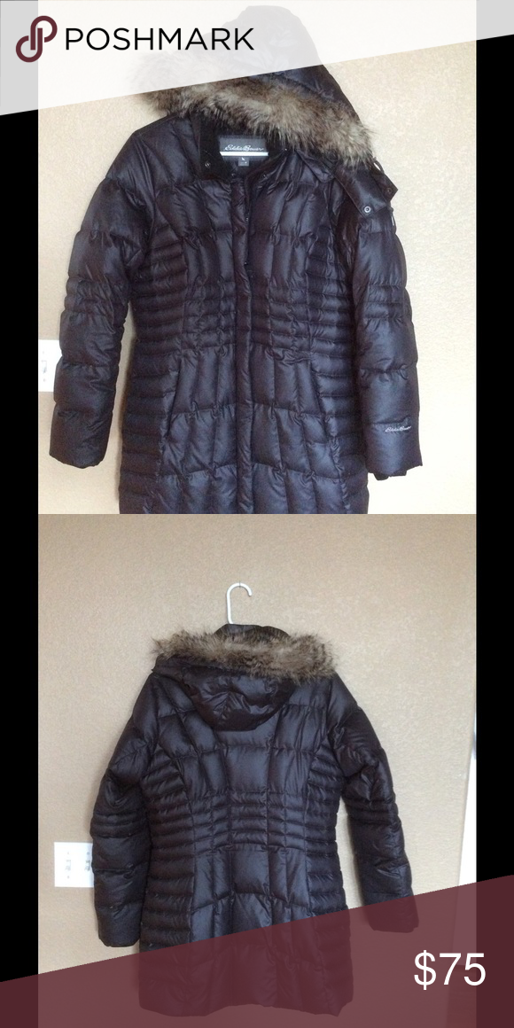 Eddie Bauer parka with removable faux fur hood Like new Eddie Bauer down parka.  I bought this last season for $229  but it is a bit snug for me.  I liked it so much I bought a larger size this season. The color, according to Eddie Bauer is black,  but I feel it is more like dark charcoal/black.  Very comfortable, warm jacket. Eddie Bauer Jackets & Coats Puffers