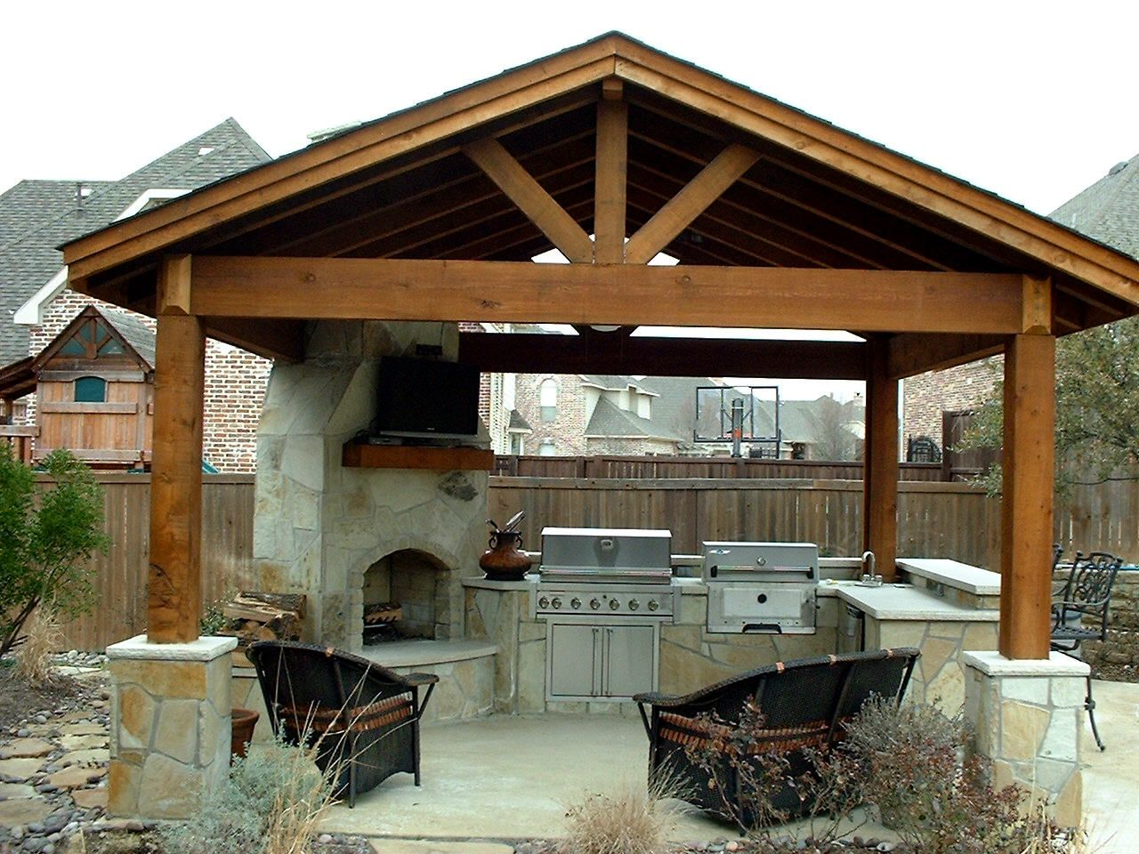 Kitchen, Breathtaking Outdoor Kitchens With Fireplace With Black Sofa  Colors And Excellent Canopy Also Wooden Cabinets With Fireplace And Bar Top  Also Black ...