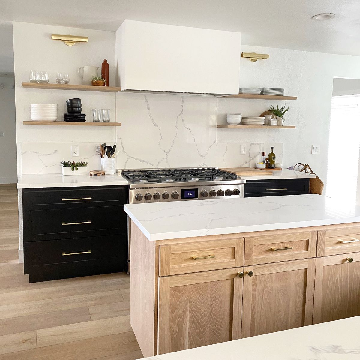 Floating shelves. White oak cabinets. Light floor. Black kitchen cabinet. Marble ba… in 2020 ...