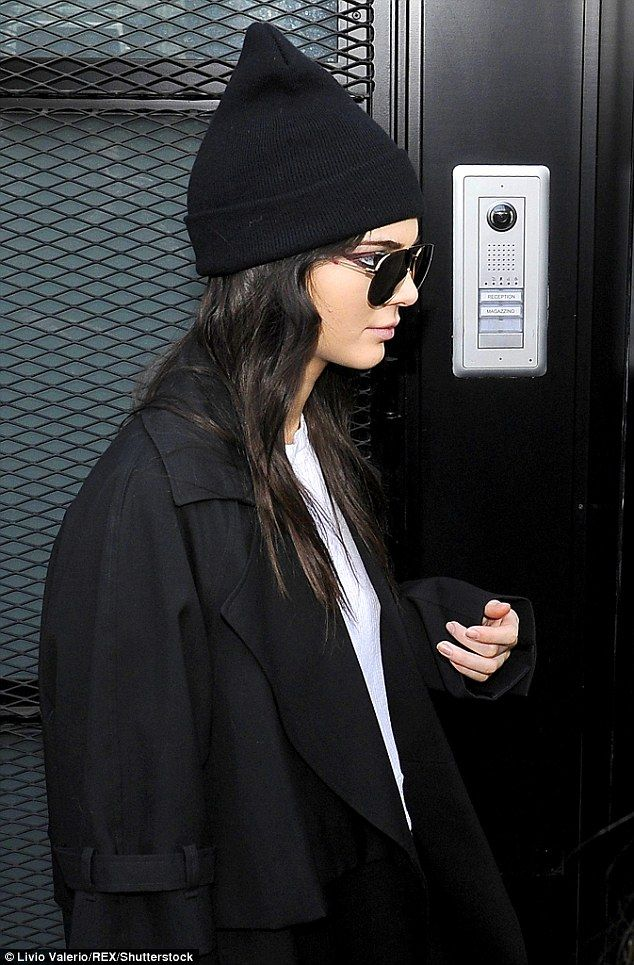 9e6bea08b50b47 Let the good times roll: The 20-year-old model looked happy and cheerful as  she headed out and about wearing a pointy black beanie hat and designer  shades