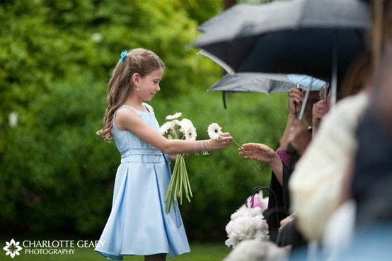 8cfaac26a Love this idea for the flower girl. Instead of making a mess of the church with  flower petals, the flower girl can hand out stemmed flowers to those on the  ...