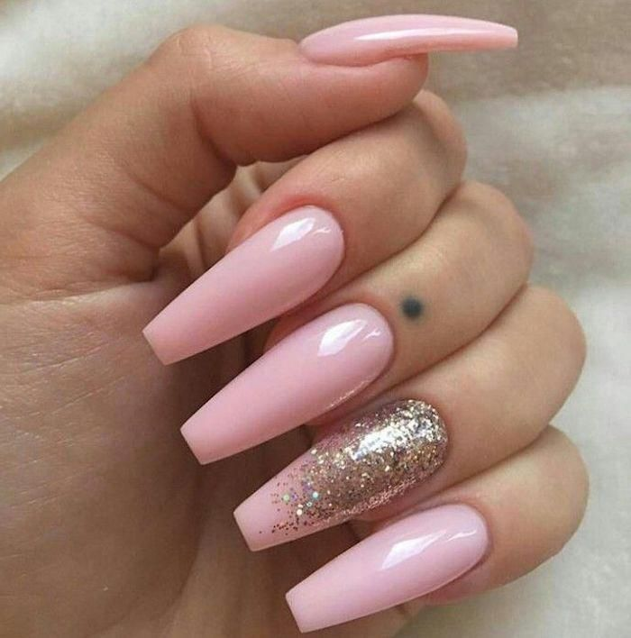 Folded Fingers With Long Coffin Nails Painted In A Pale Baby Pink Hue The Ring Finger Nail Is Decorated Coffin Shape Nails Pale Pink Nails Pink Acrylic Nails