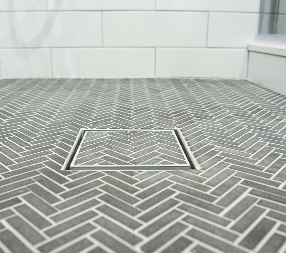 Linear Shower Drain And Trench Drain Systems Infinity Drain Infinity Drain In 2020 Hidden Shower Shower Drain Herringbone Tile Bathroom