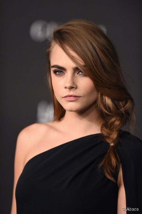 Cara Delevingne attends the 2014 LACMA Art + Film Gala presented by Gucci at LACMA in Los Angeles, CA on November 1. Alos, HAIRSTYLE TUTORIAL: Loose Side Braid.