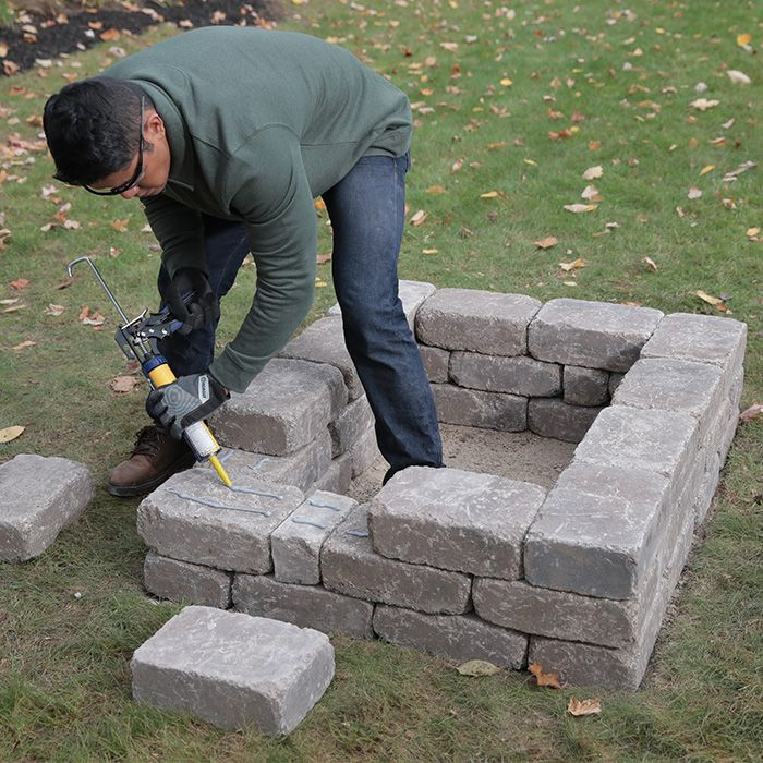 laying third row of retaining wall blocks custom fire on wall blocks id=44511