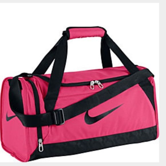 77123d4b6323 Pink nike duffle bag Pink nike duffle bag. Small. I used this as a track bag  for a season. Great condition Nike Bags Travel Bags