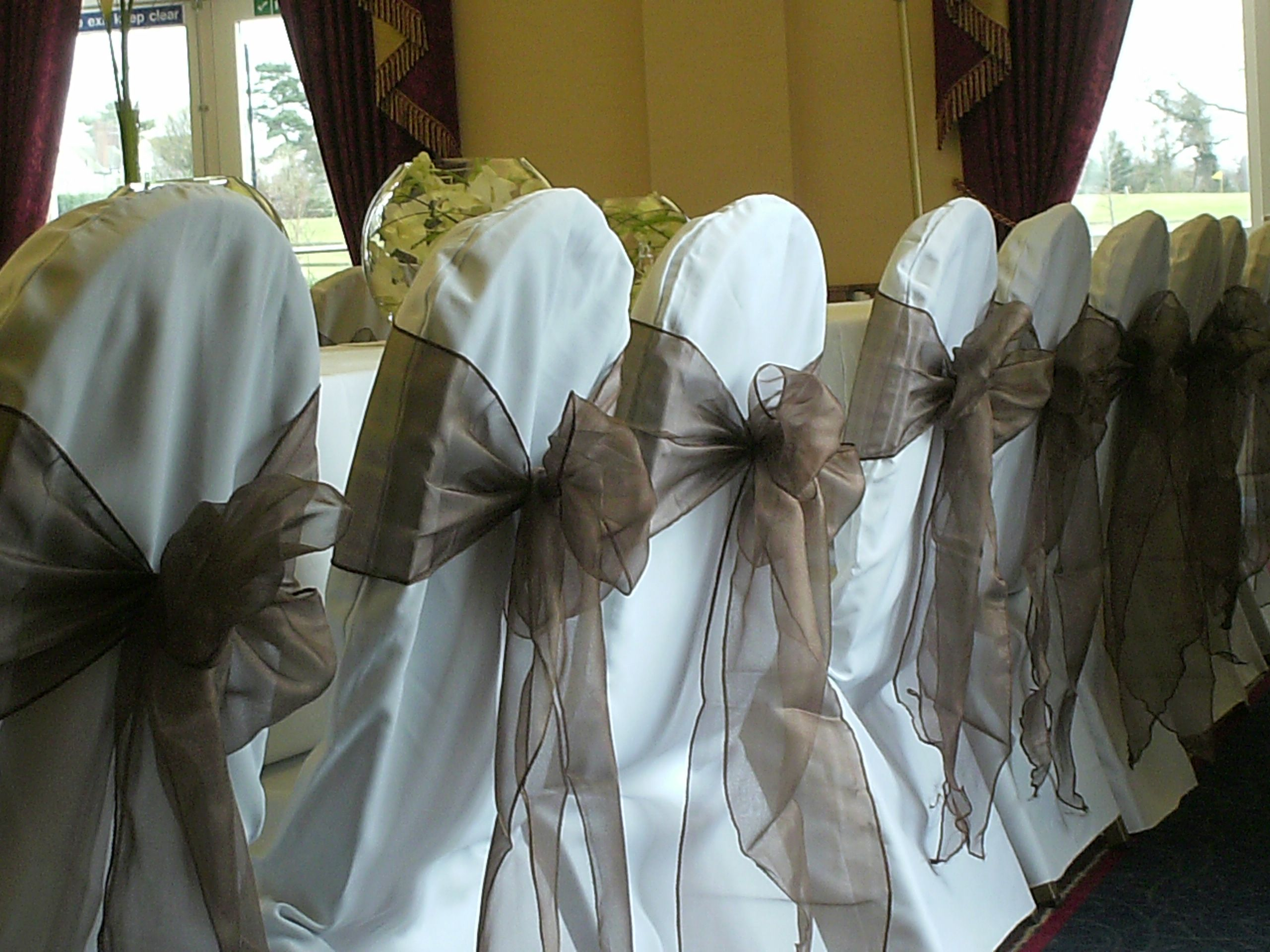 20523472faf455 Chocolate Organza Bows on White Chair Covers