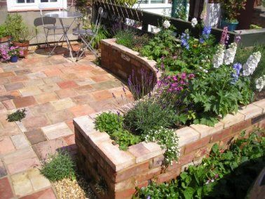raised garden design on curved raised bed made of reclaimed brick