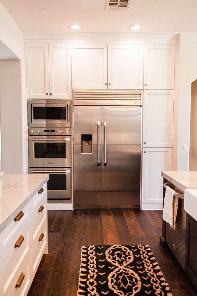 These Frameless Alpine Cabinets In Frost Paint Fit Perfectly Around These  Stainless Steel Appliances With These Beautiful Hardwood Floors