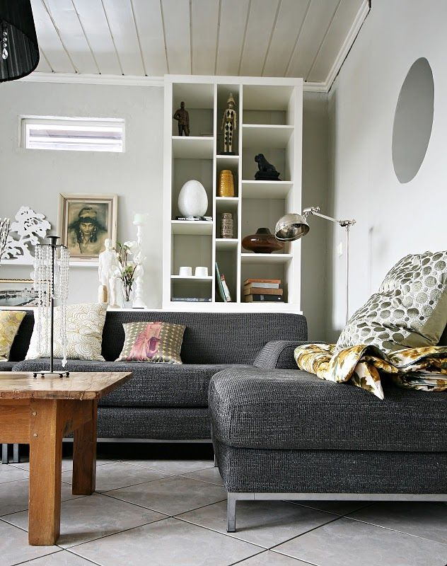 i really like the use of a large dark sofa in an otherwise relatively stark white space