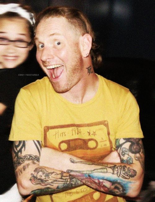 Corey Taylor and his stepdaughter (or at least i think, He only has two children and his daughter is over eighteen.) He's awesome.