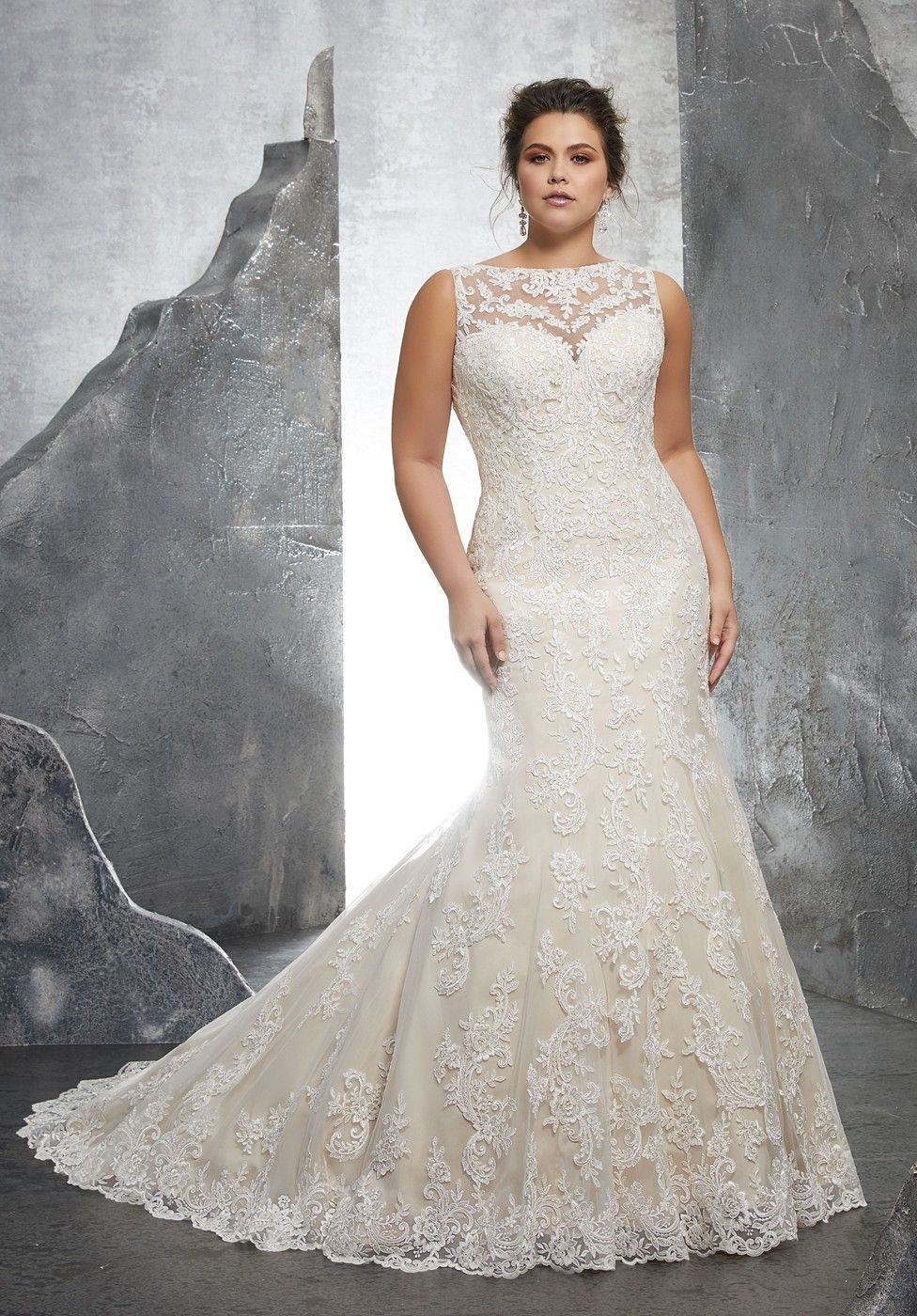 8110fb6163a This Mori Lee Julietta 3233 Keri sleeveless plus size wedding gown features  an illusion bateau neckline