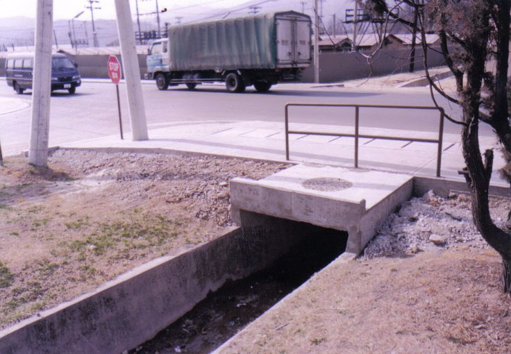 1998 - Turtle Ditch with a manhole cover!  To this day, the ditch is still opening according to my Scouts on the ground there at Camp Casey, Korea.   :-)