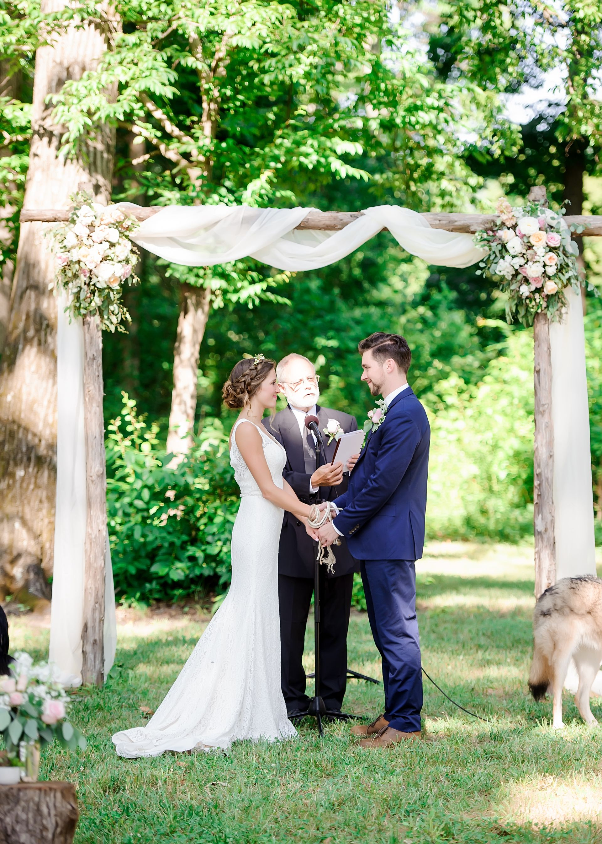 Romantic Wooden Arbor For The Wedding Ceremony Draped In Soft White Fabric Pastel Pink And Peach Floral Wedding Trellis Wedding Arbors Woods Wedding Ceremony