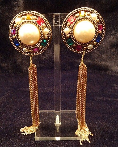 Vintage Earrings Pearls Chains Colored Gems Long Dangle Unique Wire When you wear my jewelry you get remembered. It's like a certain glance you give a man with your eyes or a subtle laugh that a man never forgets. What I sell, is something unforgettable!   By VintElegance.com