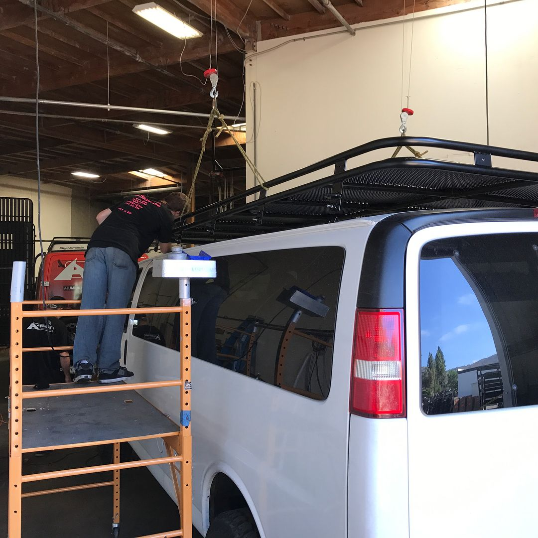 Chevy van getting a roof rack installed at Aluminess