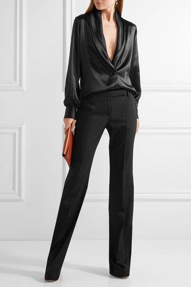 Loewe blouse, Alexander McQueen pants, Victoria Beckham clutch