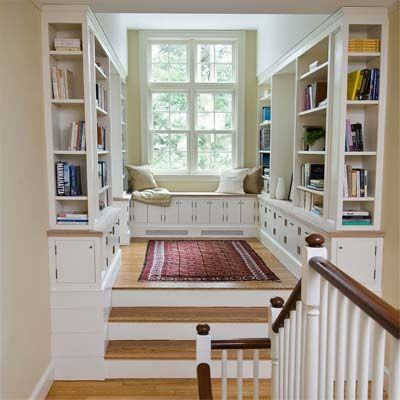 A library with cozy reading nook at the top of the stairs of the Newton Centre Project House. | Photo: Michael Casey | thisoldhouse.com