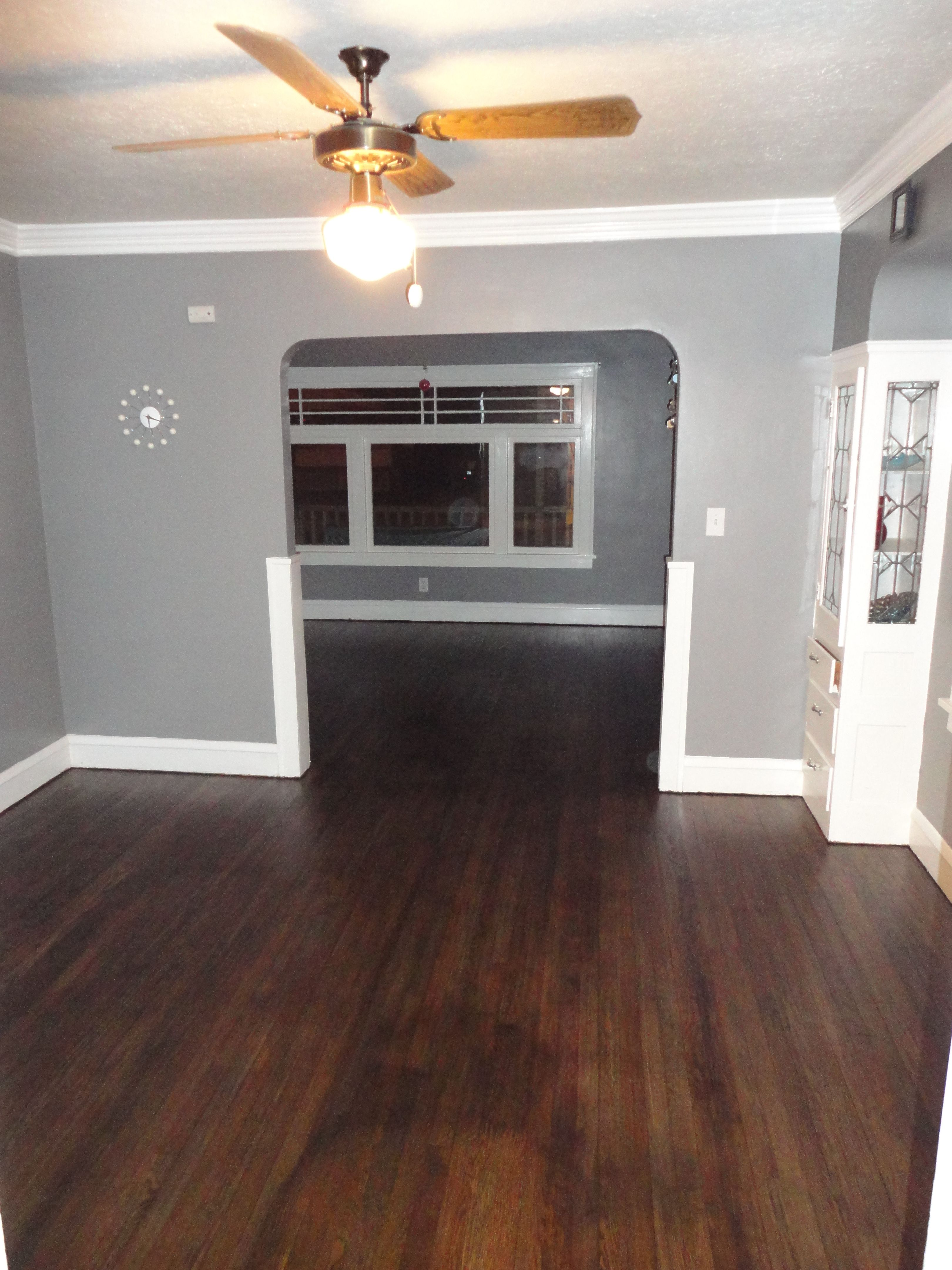 My New Look Living And Dining Room Area With Freshly Painted Walls And Trim And Stained Hardwood Floors In Grey Hardwood Floors Grey Walls Trendy Living Rooms