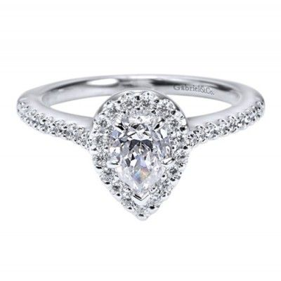 Engagement Ring Trends for 2015 - Fancy shape diamonds like this pear cut halo style