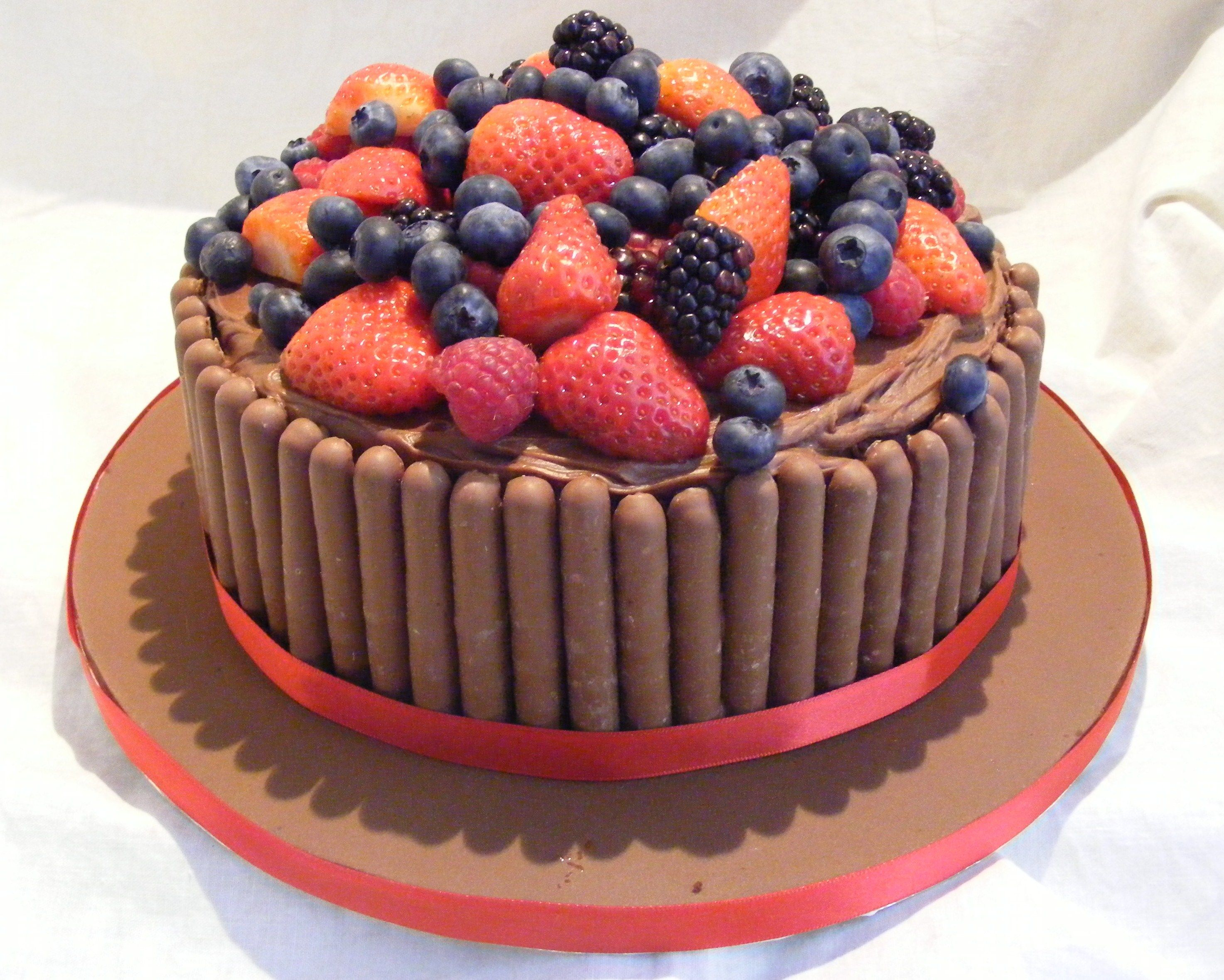Chocolate fudge cake topped with fresh mixed berries and