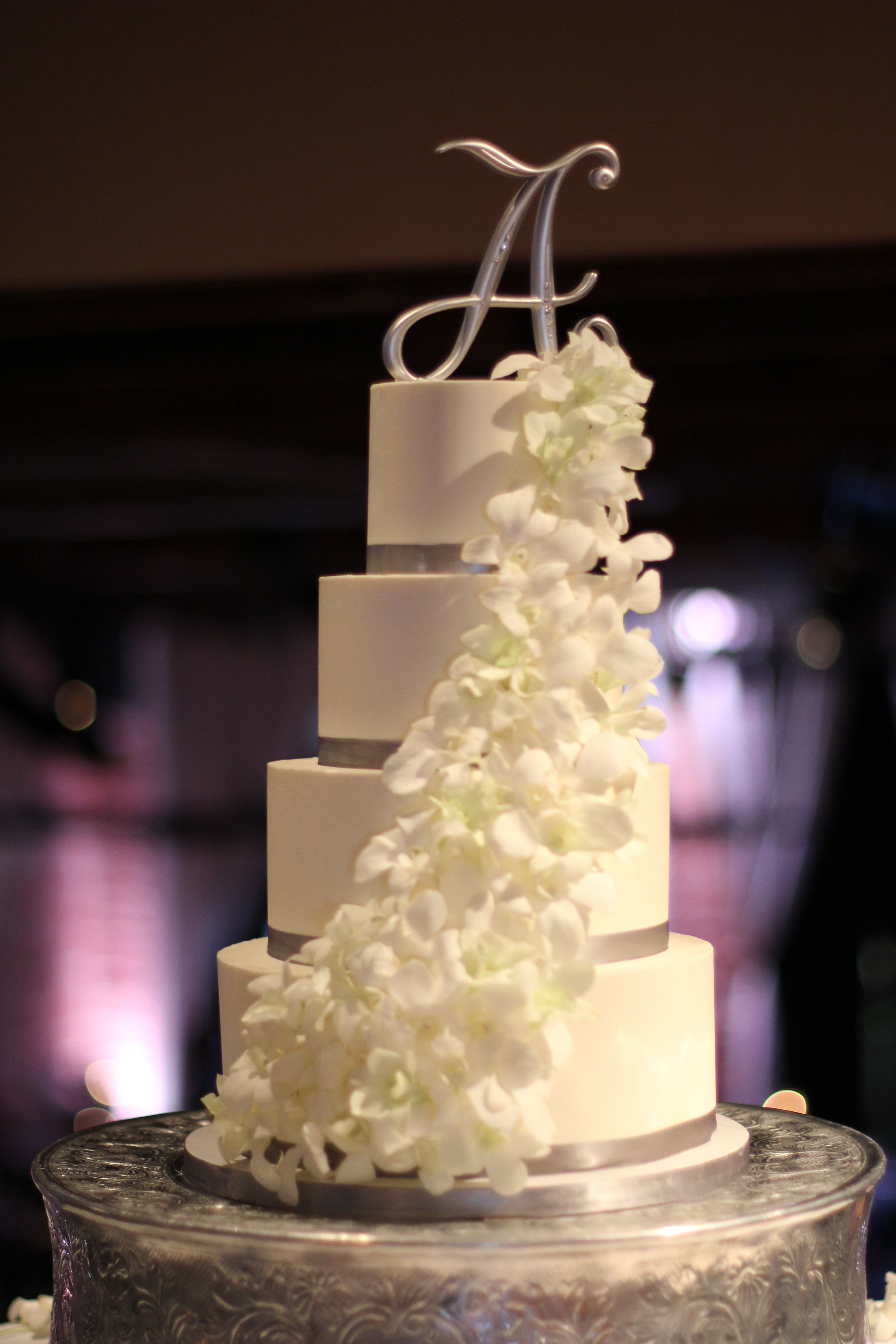 White and Silver Wedding Cake with Cascading Orchids / Hands on ...
