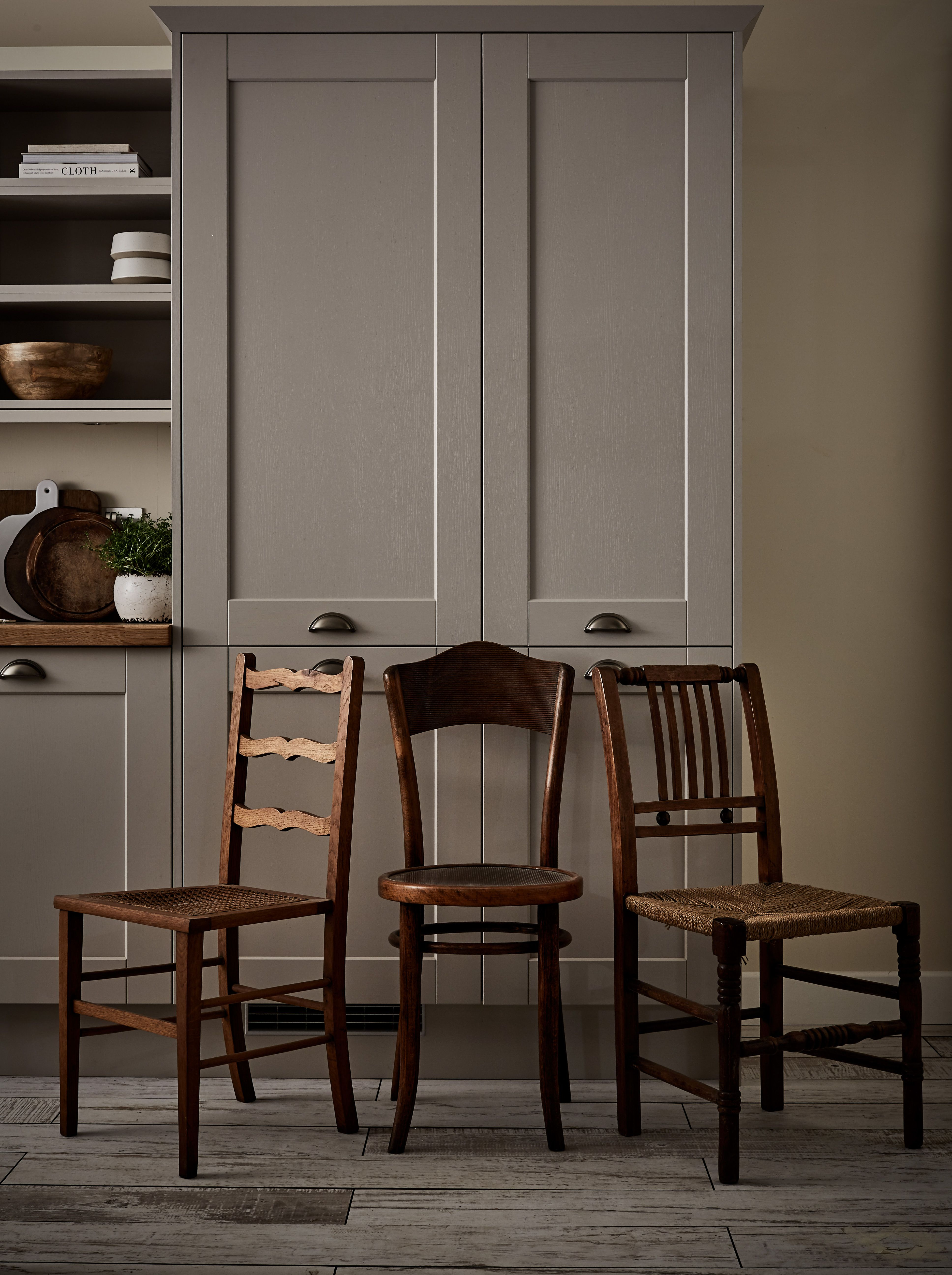 mix and match reclaimed chairs in similar tones to complete the burford grained stone kitchens are beautiful in any home