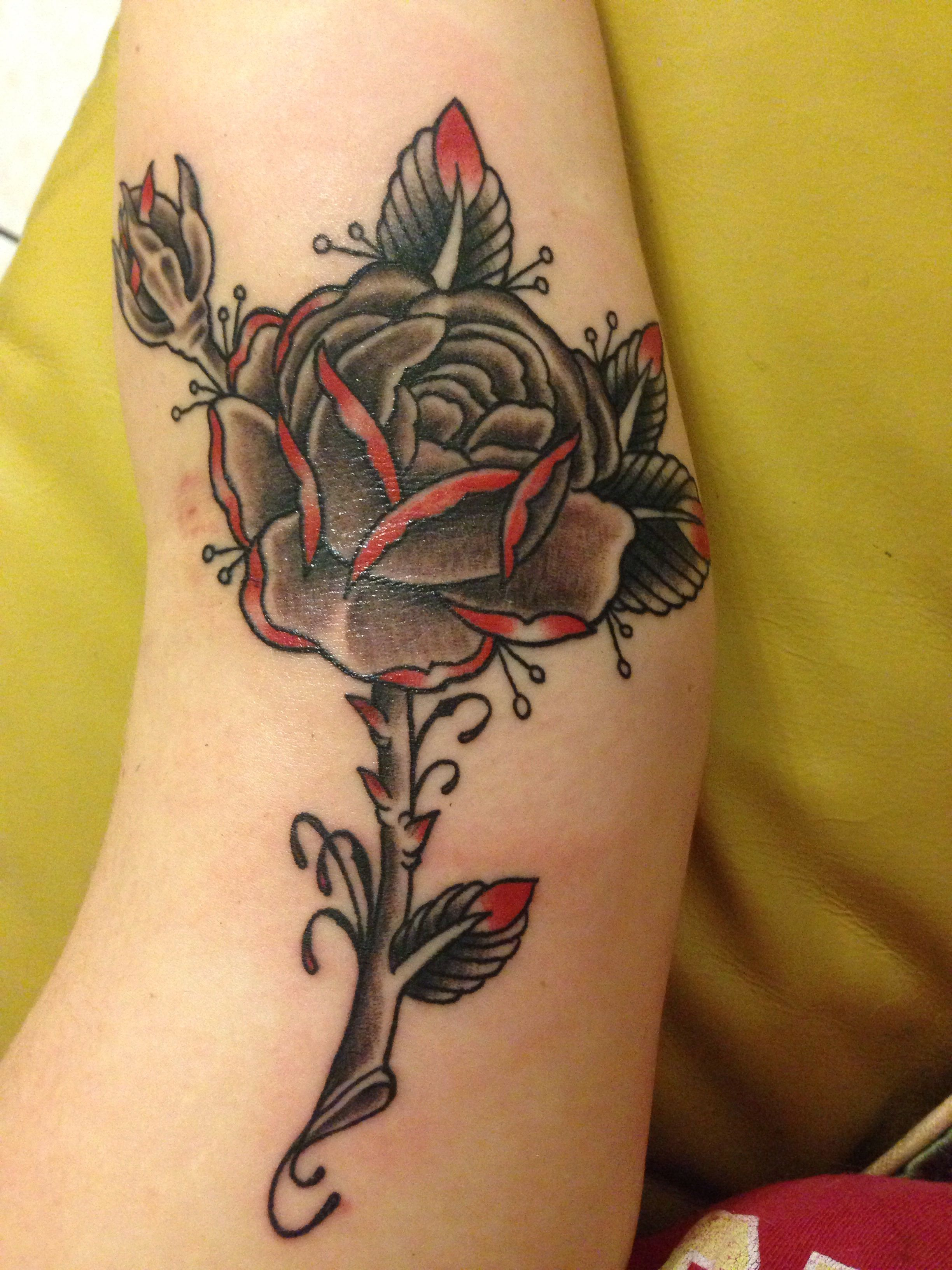 Black & grey with red rose tattoo done at Kreepy Tiki tattoo in ft ...