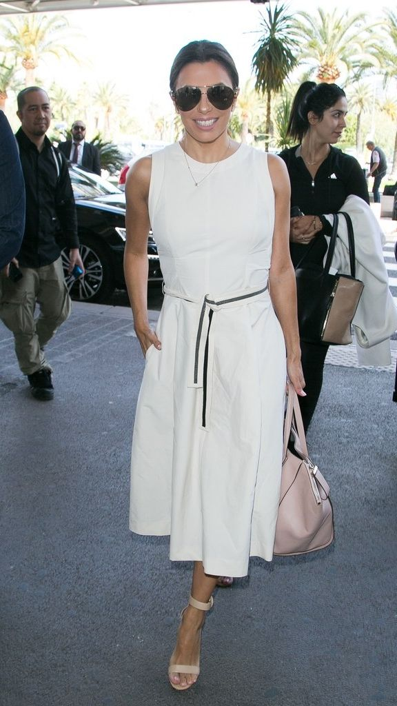 Need outfit inspiration for summer? Eva Longoria's simple white dress is the perfect outfit for traveling, parties, work, and even can be dressed down for a nighttime event.