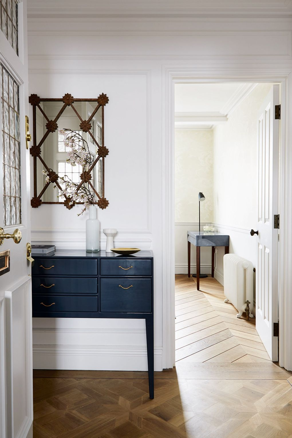Small hallway furniture  The mirror above the hall table is decorative while also creating
