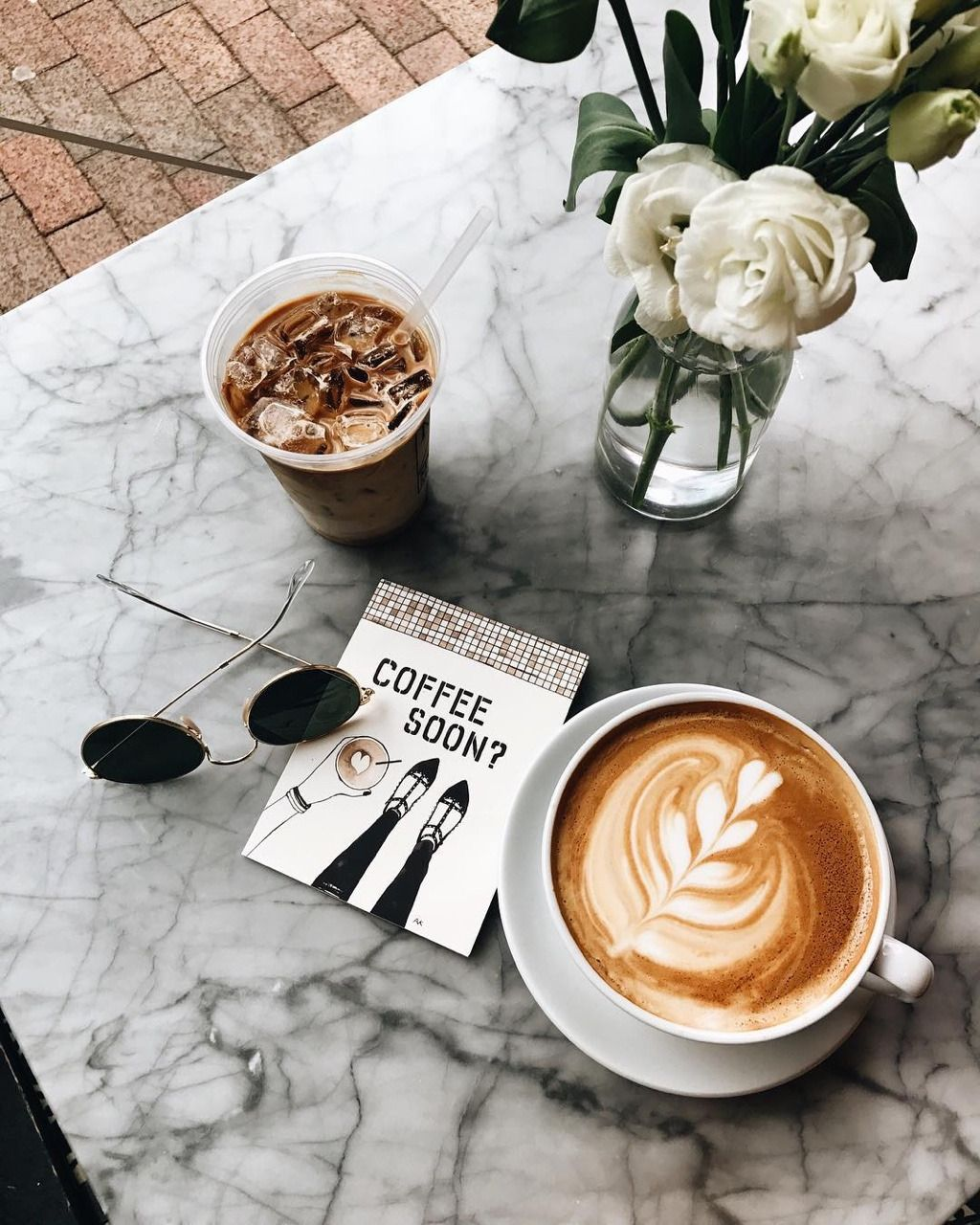 Cute Marble Table Top With Latte And Iced Coffee Atop