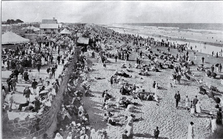 A crowded New Brighton beach, New Zealand, on gala day 1927
