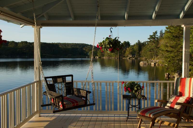 Classic shingled lakeside cottage on maines beautiful