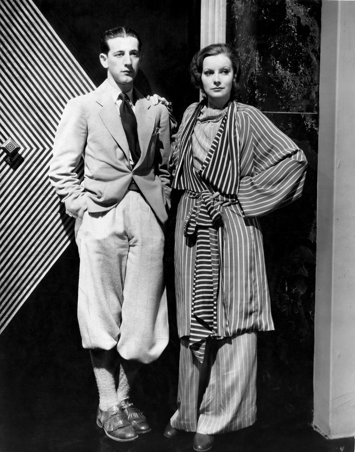 1929 : designer Adrian posing with Garbo at MGM