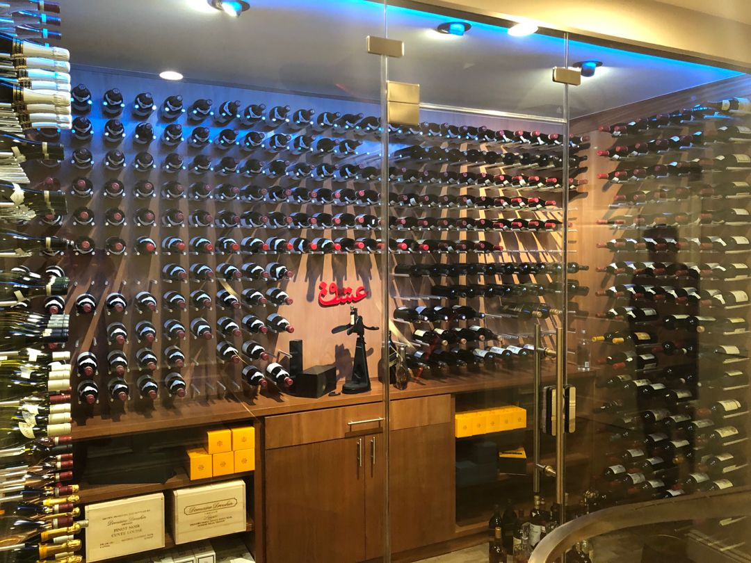 This Glass Enclosed Wine Room Has Climate Control Led Lighting