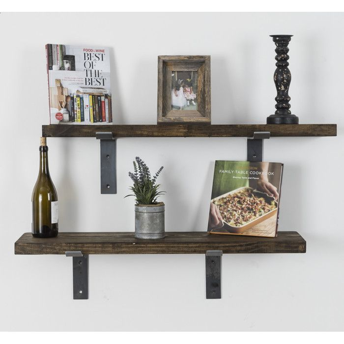 floating shelves with purposely exposed industrial brackets