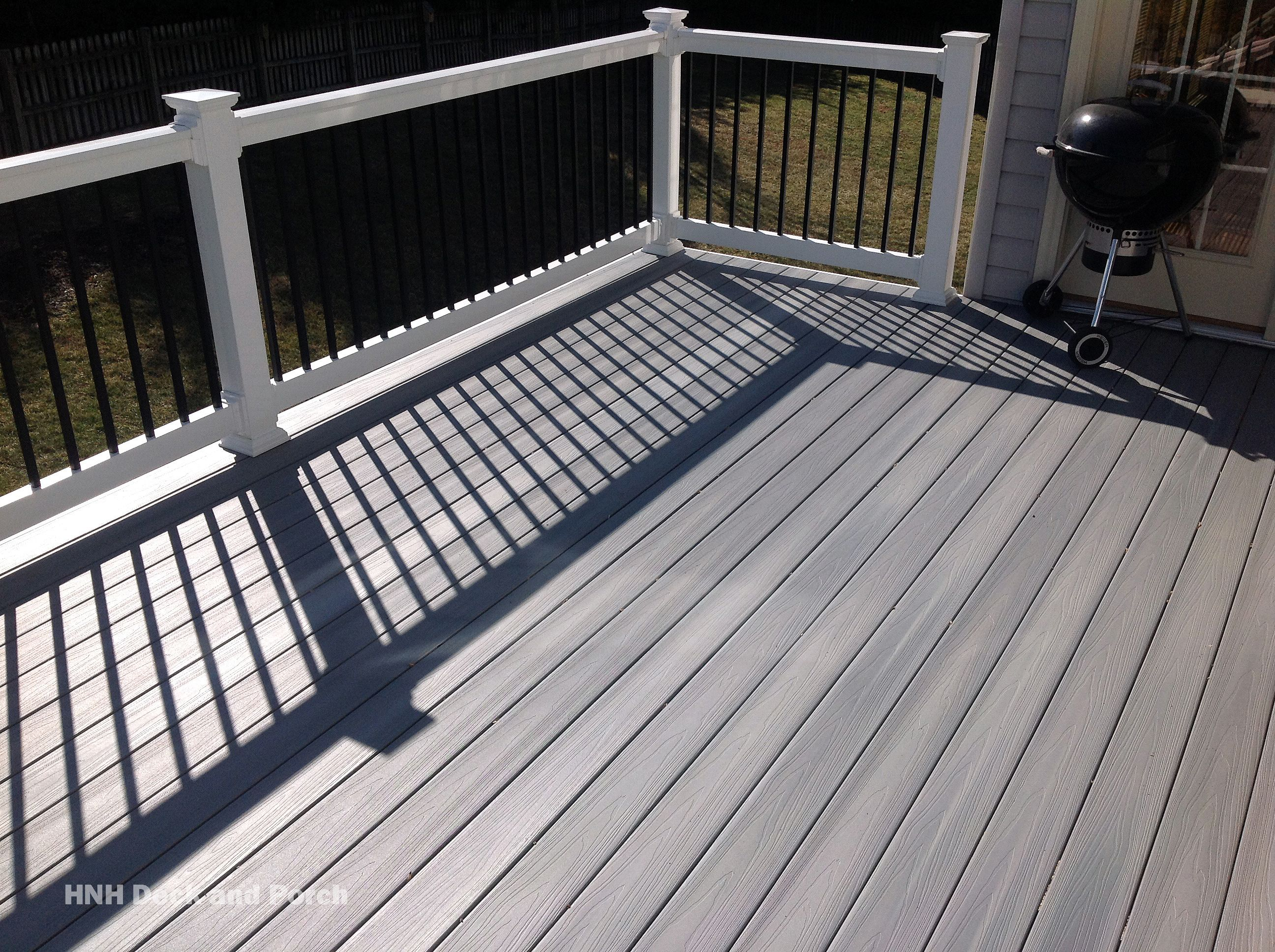 Composite Deck Using Fiberondecking Capstock Castle Grey Decking With White Pvc Railing And Black Square