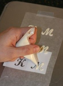 Stencils under wax paper for chocolate letters.