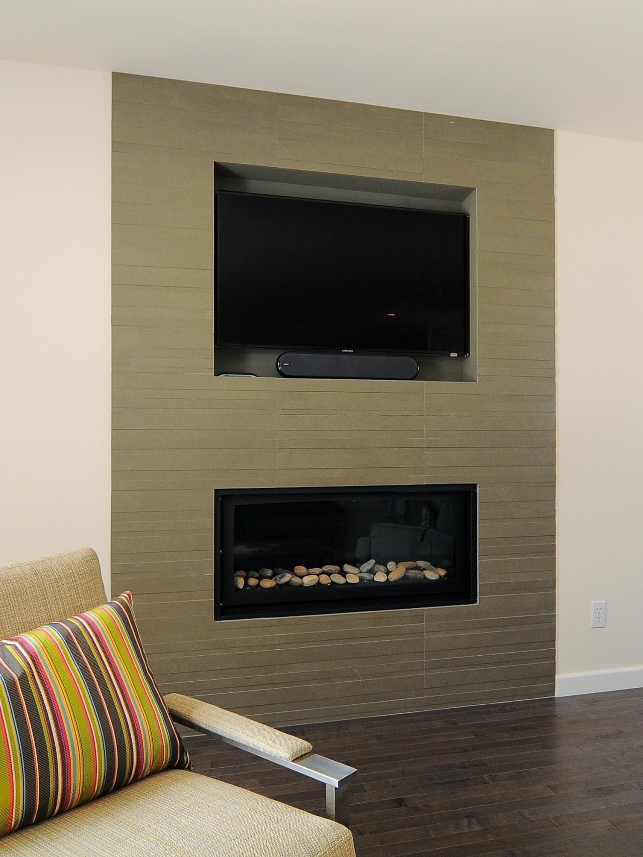 This Floor To Ceiling Fireplace And TV Combo Provides Entertainment And A  Beautiful Focal Point For This Modern Space. Stone Tile And River Rock Add  Warmth ...