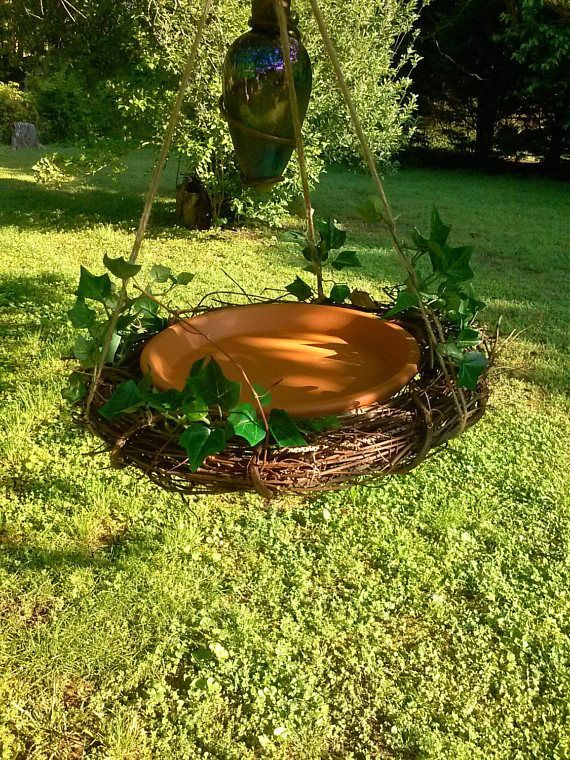 This grapevine clay saucer bird bath or bird feeder is made of an 18 grapevine, 12 clay saucer and twine hangers. A plastic ring is used at top for easy hanging. It is great for any outdoor area ie: tree, shepherds hook, patio, apartment, nursing home window etc. Great for anyone,