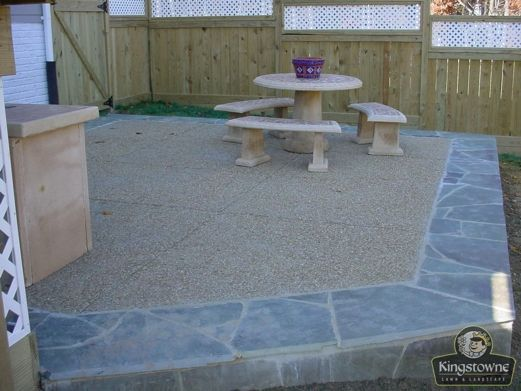 Exposed Aggregate (Concrete) Patio With An Irregular Flagstone Border