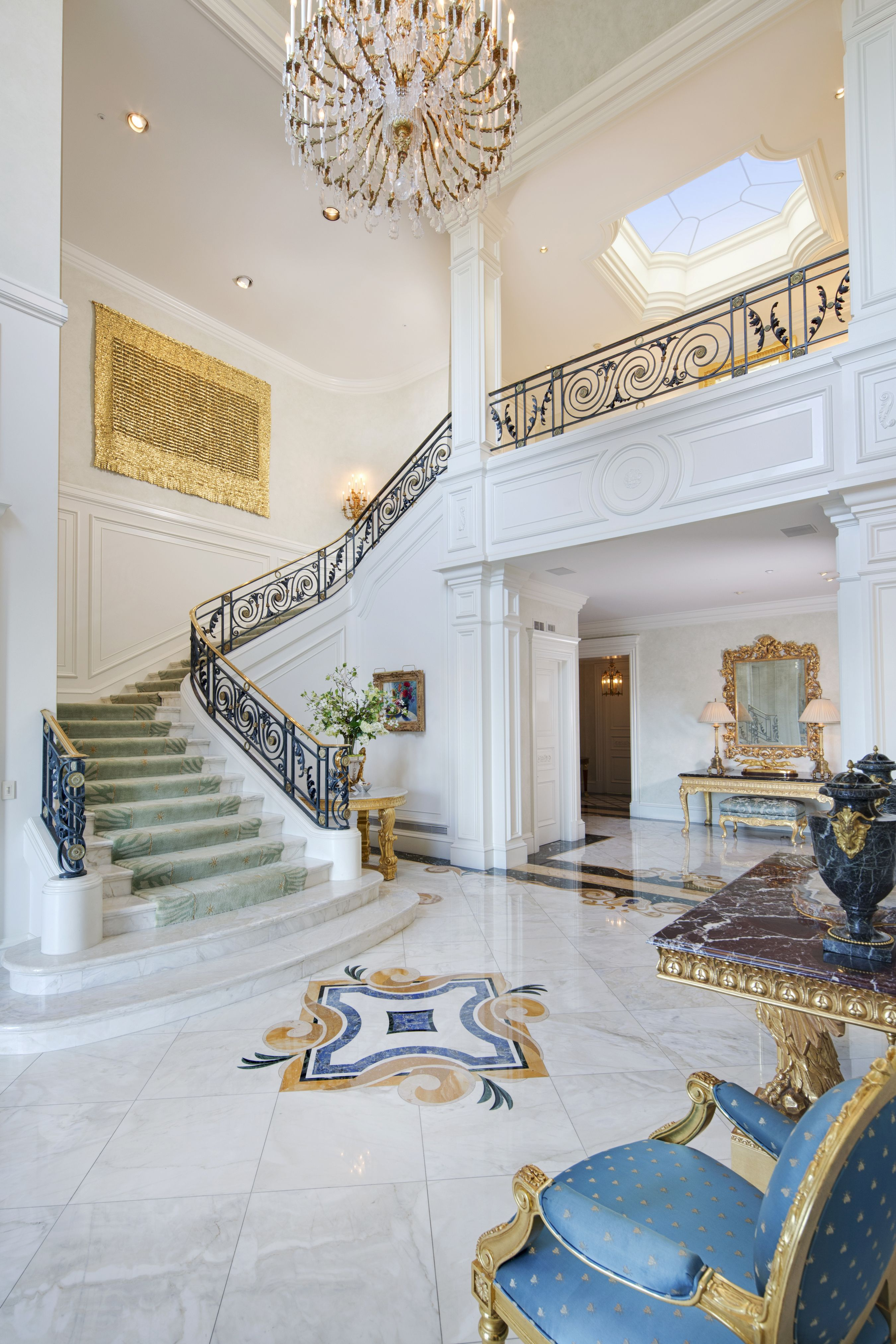 This estate features a 40 foot high entry with a center