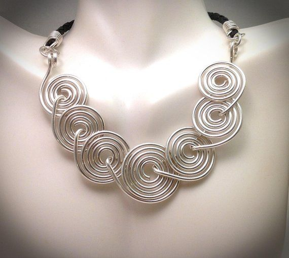 Photo of Wire wrapped jewelry. Wire jewelry. Handcrafted jewelry. Large spiral silver wirewrapped statement necklace with black leather cording