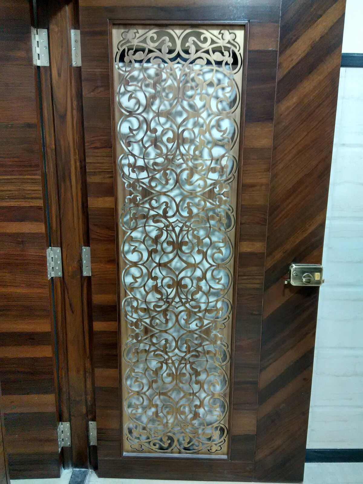 Laser cut main door grill in brass antique finish for Main entrance door design