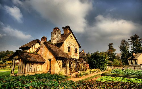 Queen's Hamlet at Palace of Versailles. I first saw this in high school and ever since the French Cottage look has been my dream home!