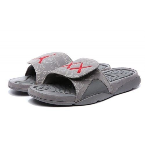 2563c8b6c buy fashion Buy KAWS x Air Jordan 4 Cool Grey Slide Sandals  grey  men   jordan